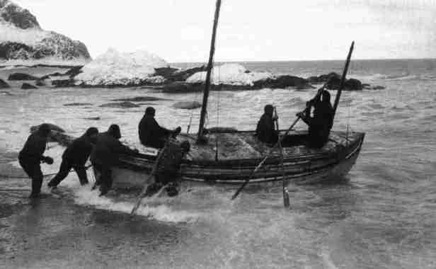Launch of the James Caird from the shore of Elephant Island.Date: 24 April 1916This photograph was published in the United States in Sir Ernest Shackleton's book, 'South', William Heinemann, London 1919.Photo Credit: Likely Frank Hurley, the expedition's photographer