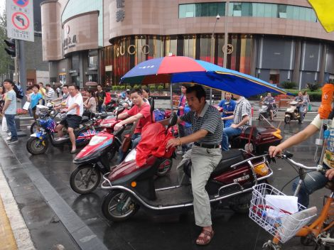 Easy way to get around in Chengdu is to ride scooters!