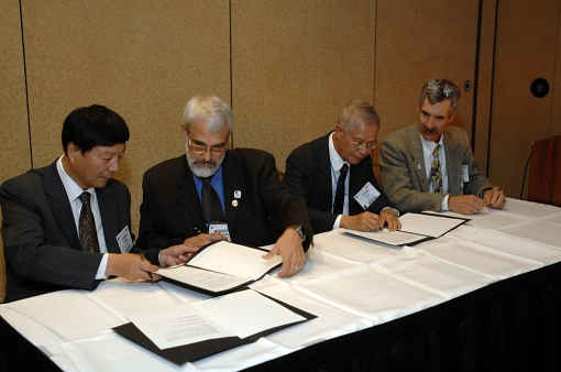 Memorandum of Understanding signing. Left to right Dr. Jingsui Yang (GSC), Dr. Jack Hess (GSA), Dr. Juhn Liou (GSA International Section), and Dr. John Geissman (GSA President). Oct. 11, 2011