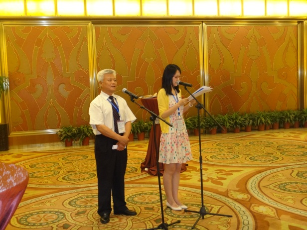 GSC Executive Vice President Xianlai Meng  gives a welcoming speech along with his interpreter.