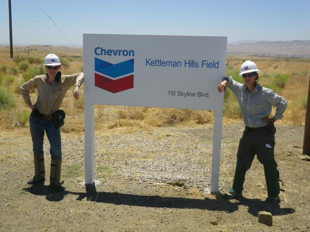 Figure 2. Two former undergraduate research students – Alice Newman '11 and Amanda Yourd '11 – braved excessive heat and likely exposure to valley fever during our summer field season in central California. Note the snake chaps and hard hats, required for safety by Chevron, which do not help one stay cool in August. Incidentally, I would like to get back into Kettleman Hills for more field work. If you work at Chevron or know someone who might help me gain access, please send me an email.