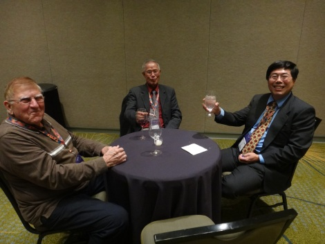 Cheers! Dr. Paul Robinson (left), Juhn Louie (center), and Dr. An Yin (left)