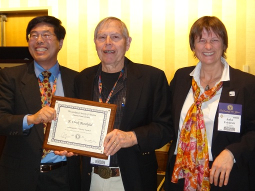 Dr. Clark Burchfiel (center) receiving Distinguished Career Award from Dr. An Yin (GSA IS Chair). Dr. Anke Friedrich (incoming GSA IS Chair).