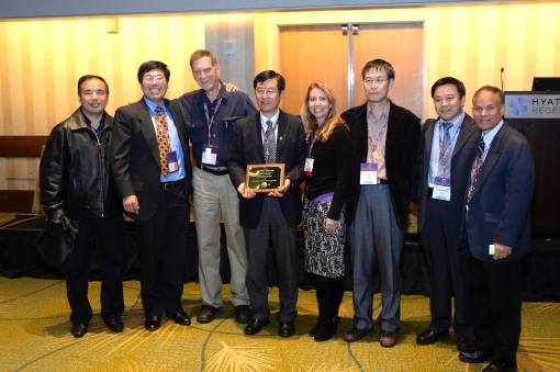Khandaker (far right) with Dr. Shuwen Dong (3rd from the left) receiving Honorary Fellow