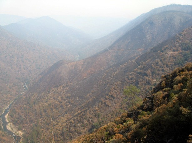 Figure 1 – The canyon of the Tuolumne River looking east (upstream) from a point on Lumsden road east of Groveland, CA.  Smoke from actively burning area of the Rim Fire obscure the more distant features.