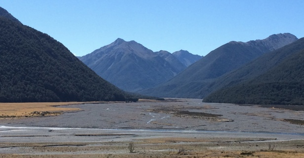 Arthur's Pass has tall mountains with big braided river valleys.
