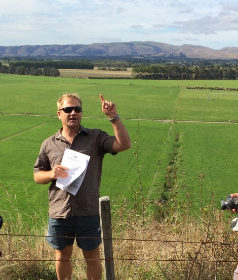 Cliff Atkins pointing out features in the Wairarapa Valley.