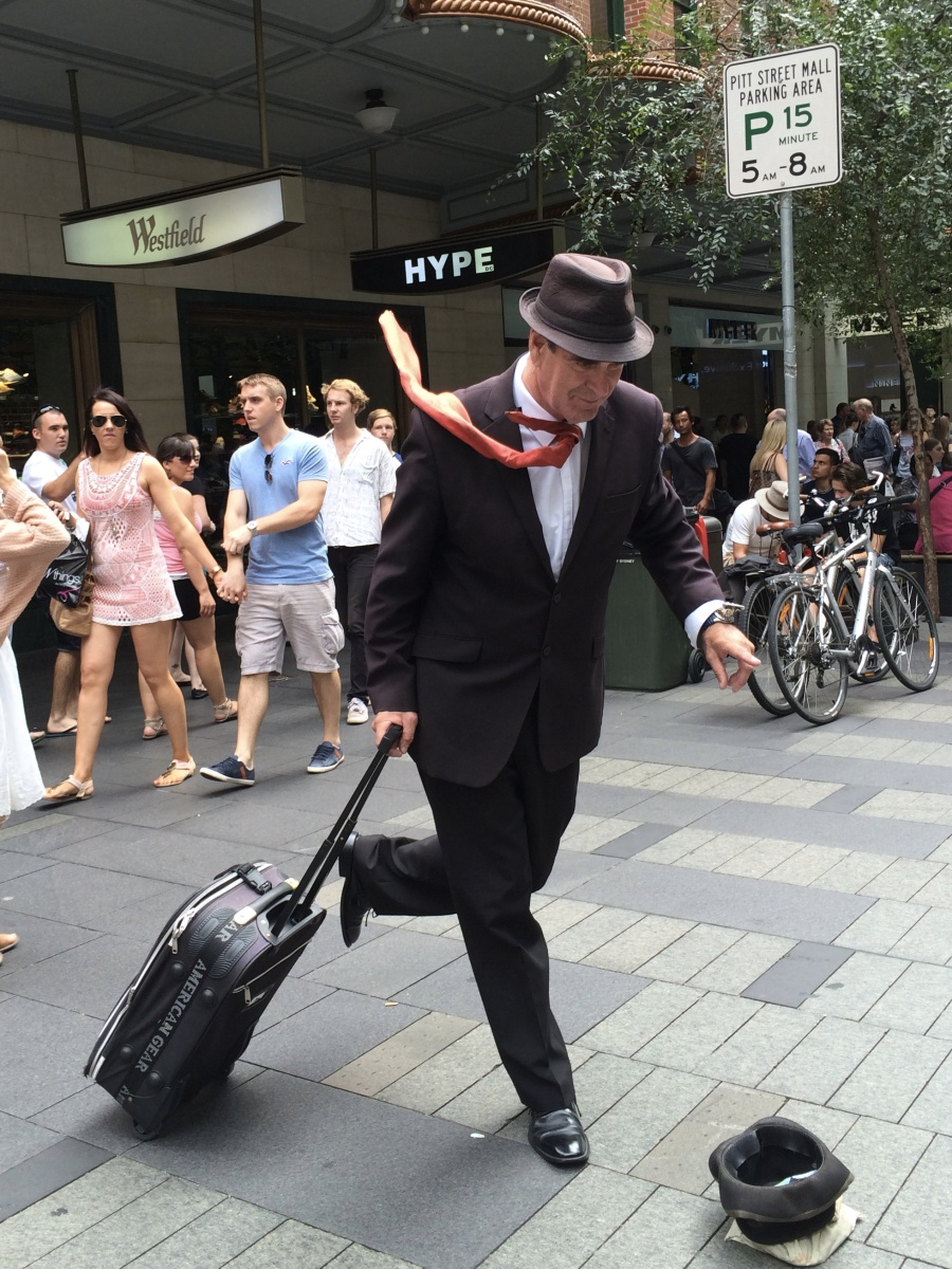 A city mime was really good and captured the rushing businessman…….