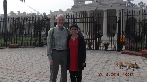 "John and I stand in front of the former Viceroy's residence at the University of Delhi (now an administrative building).  In the right background, a common scene reminds one of the term ""let sleeping dogs lie""."