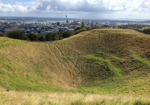 From Mount Eden, one can get a beautiful view of the city of Auckland.  The grassy foreground is a crater at the top of the cone. The sides of the cones were terraced by Maori natives for defensive stockades.