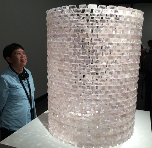 A MONA sculpture of clear calcite spar rhombs are arranged into a large cylinder.