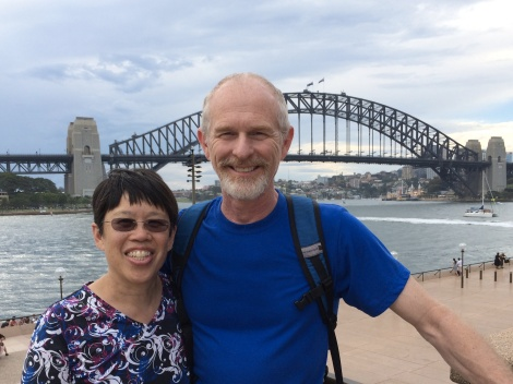 The classic Sydney harbor bridge is behind me and John.