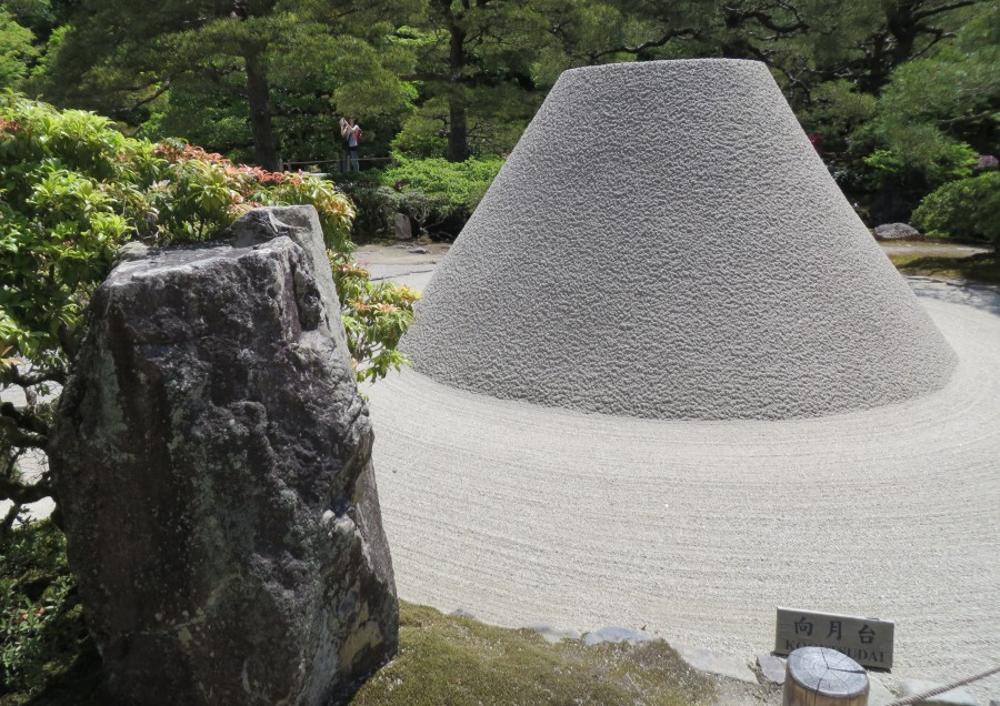 Ginkaku-ji Temple Zen monks rake and sculpture the granitic sand (from the nearby mountain) in shape of Mt Fuji, a mysterious artform.