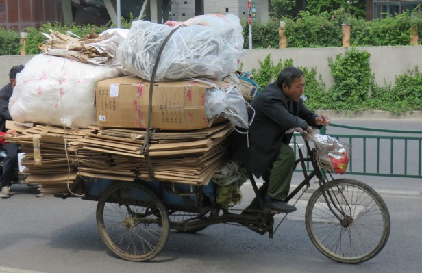 Bikes are ubiquitous in Shanghai, and some are toting heaving loads.