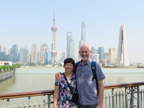 My husband John and I stand near the Bund, with the Shanghai skyscrapers in the background.
