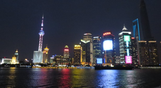 The glittery Shanghai skyline at night.