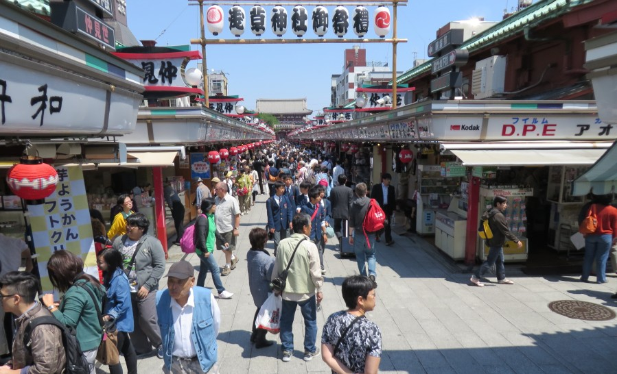 A row of shops line the path to Shinoji Temple selling all kinds of goods and tasty treats.