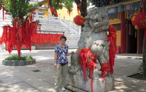 Wuhan's Changchun temple dates back to the reign of Genghis Khan, and still is a peaceful retreat with colorful red ribbons that display wishes.  Outside the temple gates, city street fortune tellers read palms and shake sticks.