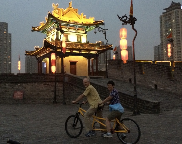 China is a mix of old and new.  Inside the 500 year old massive city walls, there are no huge high rise buildings, which helps preserve the feeling of the old.  We biked on top of the wall for the entire 14 km circumference seeing very few other riders or pedestrians, an experience to remember.