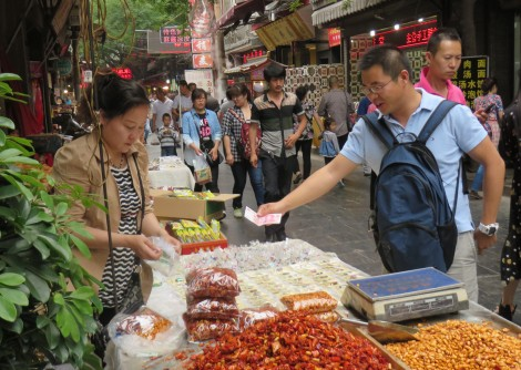 My M.S. student Kangcheng Yin has been a great help with the language, and arrangements.  He buys a batch of spicy peanuts with peppers from a vendor in the Muslim Quarter.