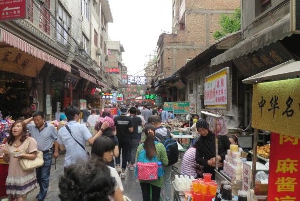 A bustling scene in the Muslim Quarter's food street.