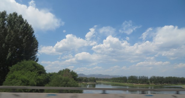 This shows one of the few days of blue sky at the very northern of Beijing where there are mountains in the horizon.