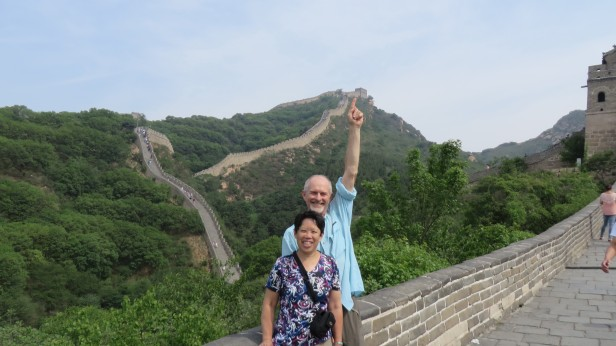 My husband John points back to one of the Great Wall gates that we had just walked from.