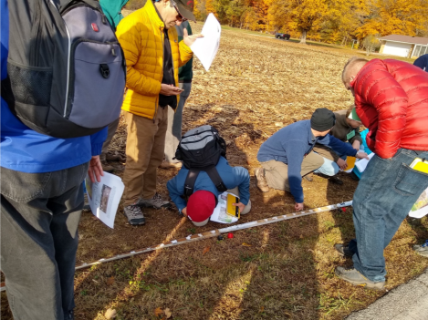 Stop 3. Dean pit (private property). Participants view a core sample obtained here to examine the stratigraphy (layers) found beneath this farm field. A gravel pit provides additional rock exposures.