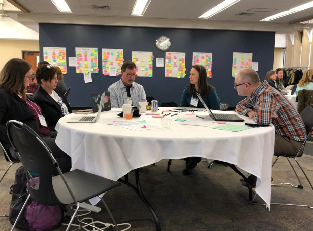 Participants engaged in a group discussion at the 2019 DEI workshop.