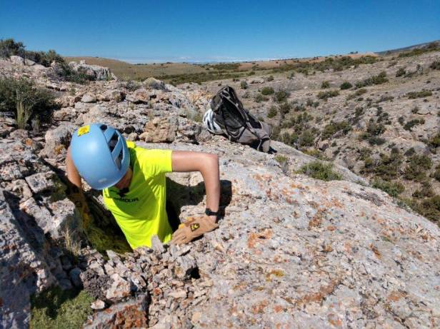 Penelope Vorster, US Forest Service, Custer Gallatin National Forest, Squeezing out of a tight karst feature in the Pryor Mountains, 2019.