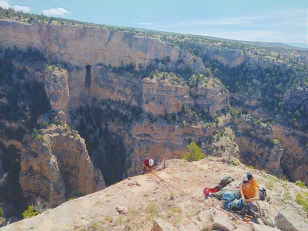 Penelope Vorster, USFS, Custer Gallatin NF, Preparing to rappel into canyon to access lead on opposite wall, MCC intern Dustin Kisner on rappel. BLM Pryor Mountains, 2019.