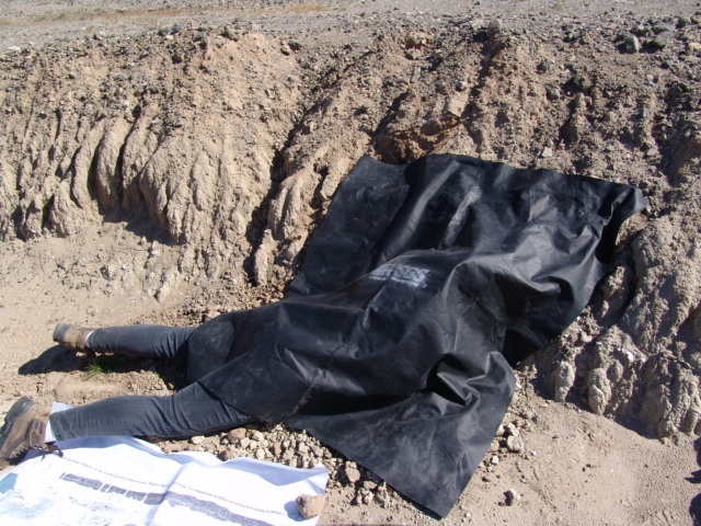 "hannon Mahan hiding beneath a black cloth. ""It looks funnier than it is,"" she noted. ""Being under that black cloth in the Mojave can give you heatstroke, but in order to collect samples for my geologic specialty, I sometimes have to protect them from light."""