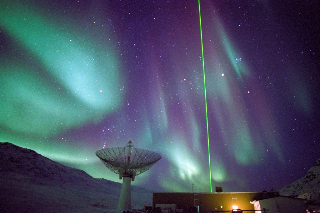 "Aurora borealis--the ""northern lights"" -- light the sky over the Sondrestrom Upper Atmospheric Research Facility in Kangerlussuaq, Greenland."